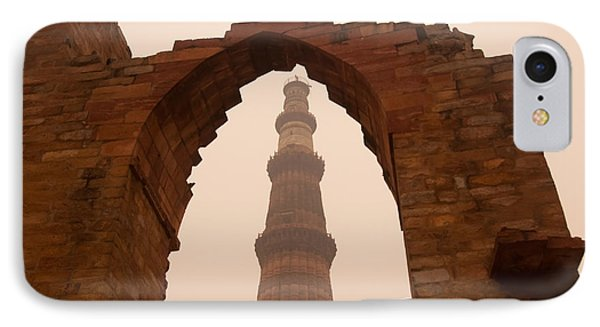 Cross Section Of The Qutub Minar Framed Within An Archway In Foggy Weather IPhone Case by Ashish Agarwal