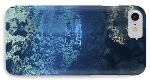 Dry Suit Divers Entering The Gin Clear Phone Case by Mathieu Meur