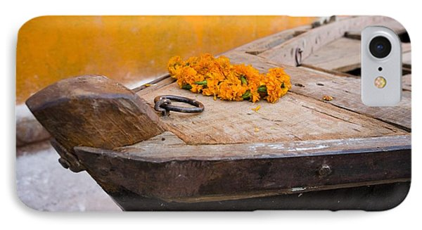 Flowers On Top Of Wooden Canoe Phone Case by David DuChemin