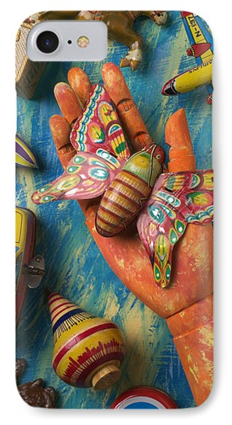 Hand Holding Butterfly Toy Phone Case by Garry Gay