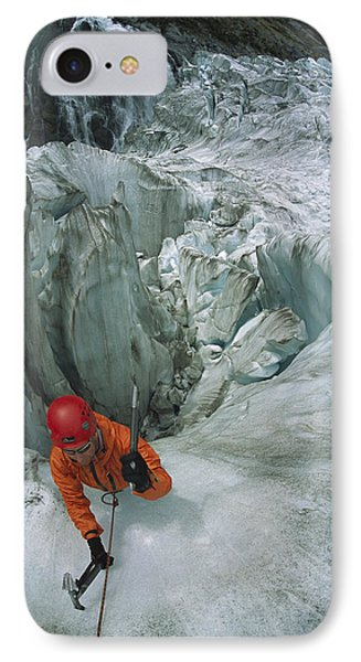 Ice Climber On Steep Ice In Fox Glacier Phone Case by Colin Monteath