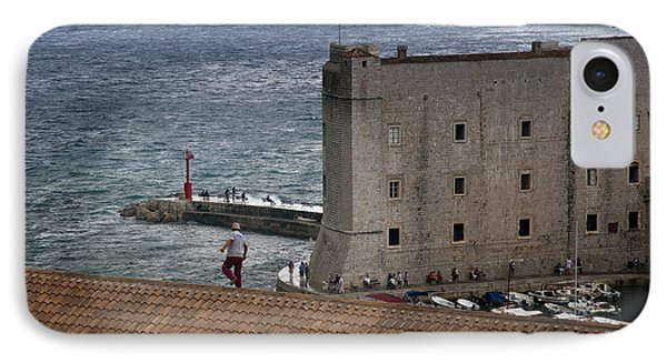 Man On The Roof In Dubrovnik Phone Case by Madeline Ellis