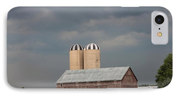 Ominous Clouds Over The Barn Phone Case by J McCombie