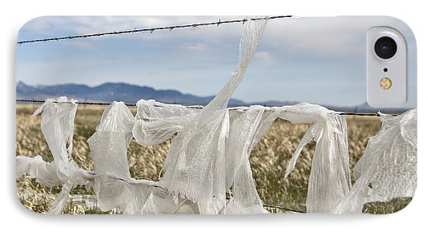 Plastic Garbage Bag On A Wire Fence Phone Case by Paul Edmondson