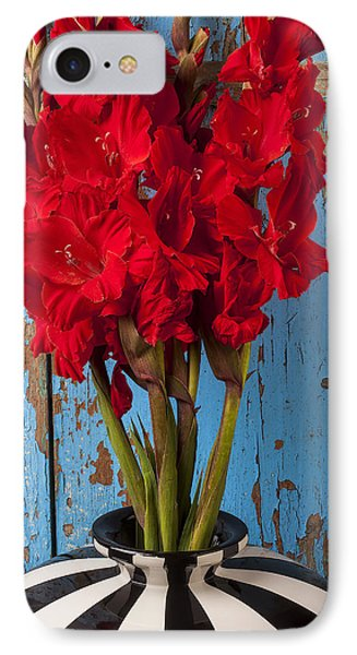 Red Glads Against Blue Wall Phone Case by Garry Gay