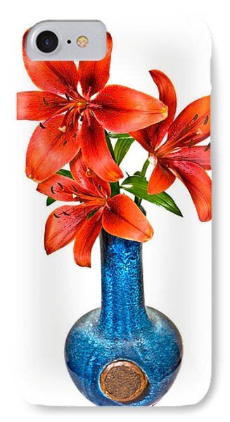 Red Lilies In Blue Vase Phone Case by Susan Leggett