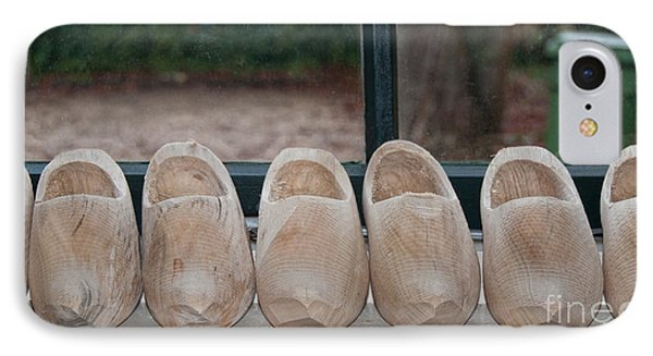 IPhone Case featuring the digital art Rows Of Wooden Shoes by Carol Ailles