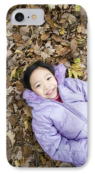 Smiling Girl Lying On Autumn Leaves Phone Case by Ian Boddy