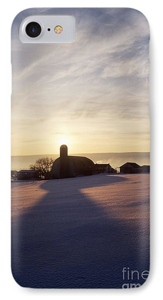 Snow Covered Field With Farm Silhouette At Sunset Phone Case by Jeremy Woodhouse