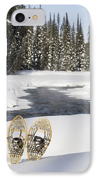Snowshoes By Snowy Lake Lake Louise Phone Case by Michael Interisano
