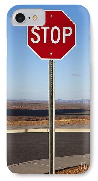 Stop Sign In The Desert Phone Case by Paul Edmondson