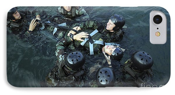 Students Secure A Simulated Casualty Phone Case by Stocktrek Images