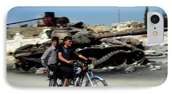Syrian Men Drive A Motorbike Phone Case by Andrew Chittock