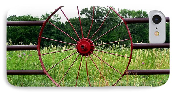 IPhone Case featuring the photograph Texas Wildflowers Through Wagon Wheel by Kathy  White