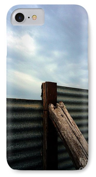 IPhone Case featuring the photograph The Fence The Sky And The Beach by Andy Prendy