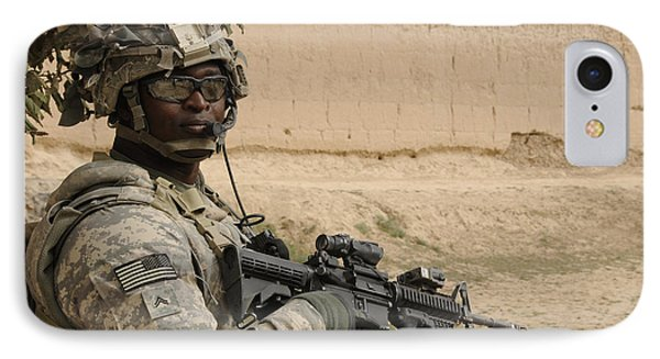 U.s. Army Soldier Scans His Area While Phone Case by Stocktrek Images