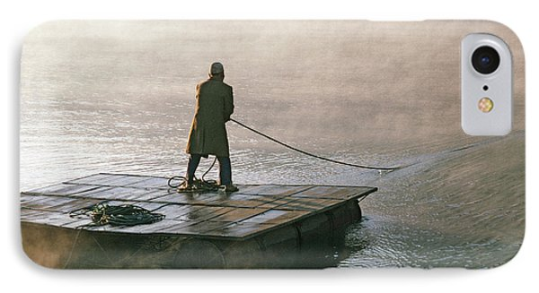 Villager On Raft Crosses Lake Phewa Tal Phone Case by Gordon Wiltsie