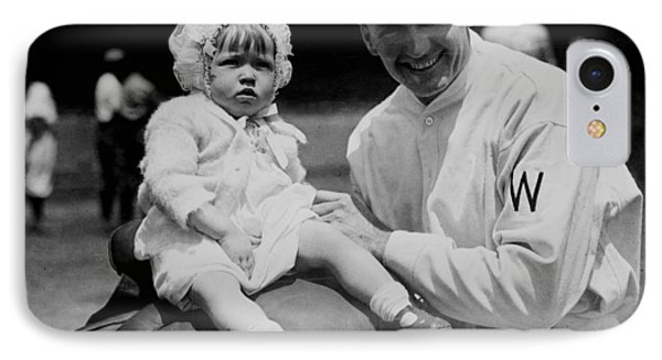 IPhone Case featuring the photograph Walter Johnson Holding A Baby - C 1924 by International  Images