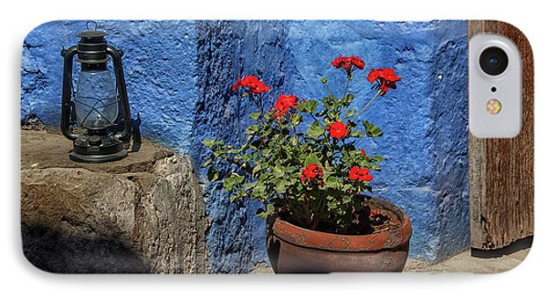 IPhone Case featuring the photograph Red Geranium Near A Blue Wall by Patricia Hofmeester