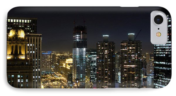 Skyscrapers In A City Lit Up At Night IPhone Case by Panoramic Images