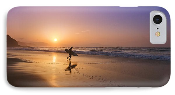 Surfer Entering Water At Sunset IPhone Case by Mikel Martinez de Osaba