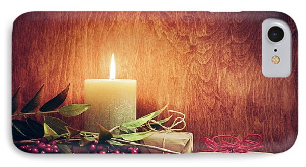 Chistmas Presents, Gifts With A Candle Glowing On Wooden Wall Background. IPhone Case