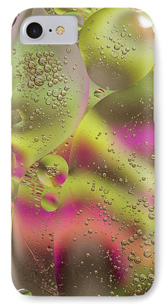 IPhone Case featuring the photograph Oil In Water by Kevin Blackburn