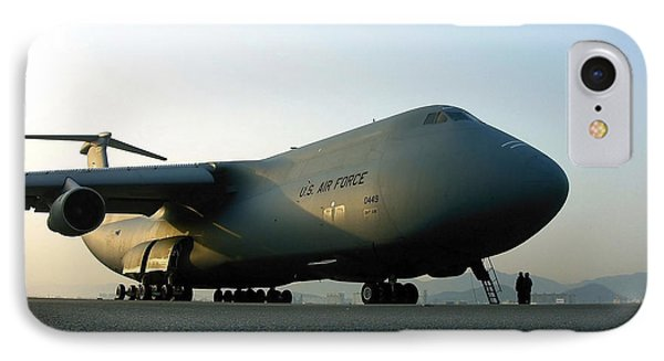 A C-5 Galaxy Sits On The Flightline Phone Case by Stocktrek Images