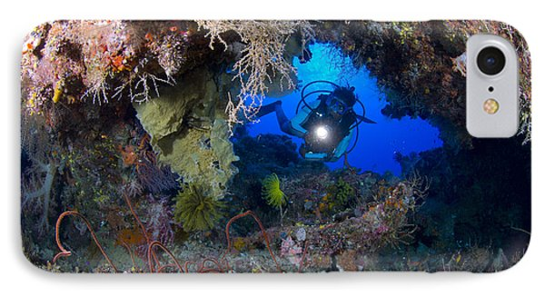 A Diver Peers Through A Coral Encrusted Phone Case by Steve Jones