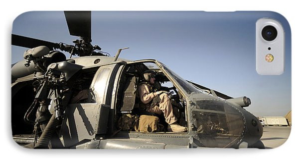 A Pilot Sits In The Cockpit Of A Hh-60g Phone Case by Stocktrek Images