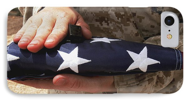 A Soldier Holds The United States Flag Phone Case by Stocktrek Images