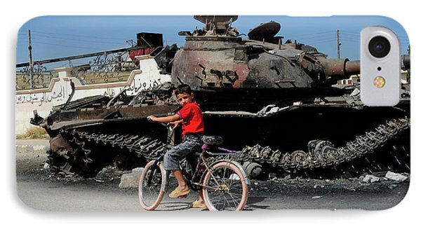 A Syrian Boy On His Bicycle In Front IPhone Case by Andrew Chittock