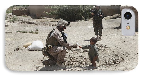 A U.s. Marine Gives Candy To An Afghan IPhone Case by Stocktrek Images