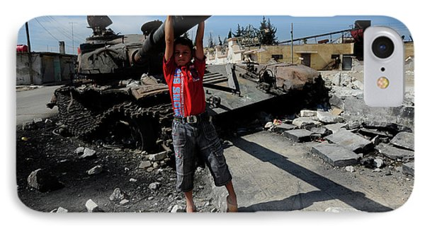 A Young Syrian Boy Plays On The Turret IPhone Case by Andrew Chittock