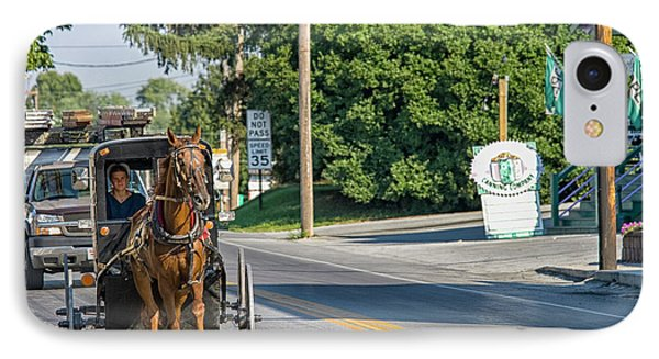 IPhone Case featuring the photograph Amish Girl On The Road by Patricia Hofmeester