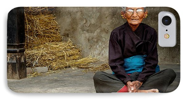 An Old Woman In Bhaktapur IPhone Case by Valerie Rosen