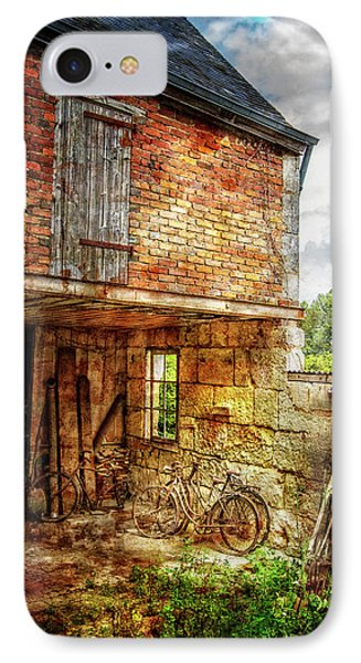 Bicycles In The Courtyard IPhone Case by Debra and Dave Vanderlaan