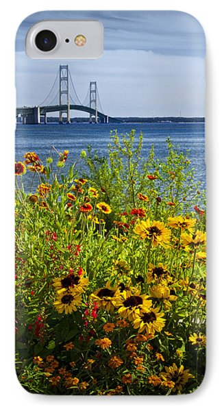 Blooming Flowers By The Bridge At The Straits Of Mackinac IPhone Case by Randall Nyhof