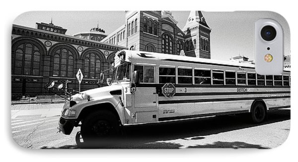 bluebird yellow school bus passing the smithsonian arts and industries building Washington DC USA IPhone Case