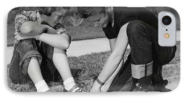 Boy Helping Girl With Roller Skates IPhone Case by H. Armstrong Roberts/ClassicStock