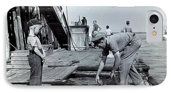 Boy Watching Fisherman Unload Lobsters IPhone Case by H. Armstrong Roberts/ClassicStock