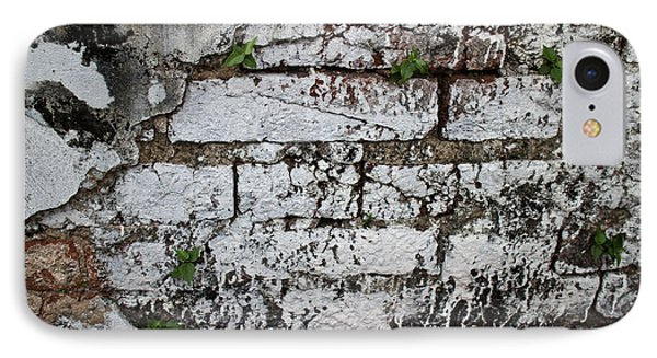 IPhone Case featuring the photograph Broken Stucco Wall With Whitewashed Exposed Brick Texture And Ve by Jason Rosette