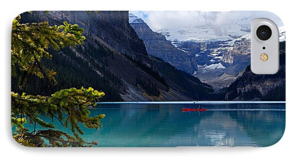 Canoe On Lake Louise IPhone Case by Larry Ricker