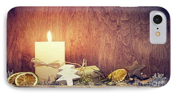 Chistmas Decoration With Candle Glowing On Wooden Wall Background IPhone Case by Michal Bednarek