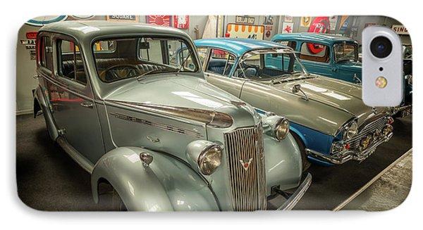 IPhone Case featuring the photograph Classic Car Memorabilia by Adrian Evans