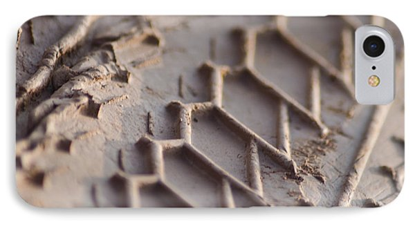 IPhone Case featuring the photograph Close Up Of Motorcycle Tread Pattern On Muddy Trail by Jason Rosette
