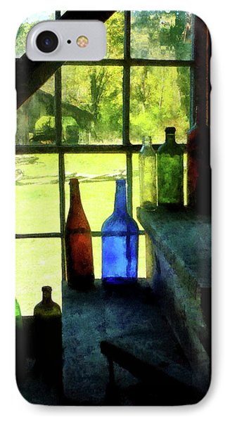 IPhone Case featuring the photograph Colored Bottles On Steps by Susan Savad