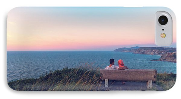 couple on bench vith view of Sopelana coast IPhone Case