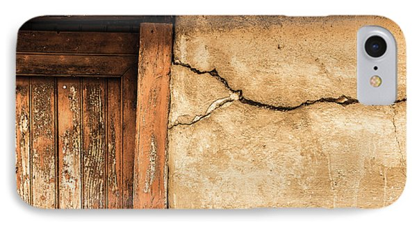 IPhone Case featuring the photograph Cracked Lime Stone Wall And Detail Of An Old Wooden Door by Semmick Photo