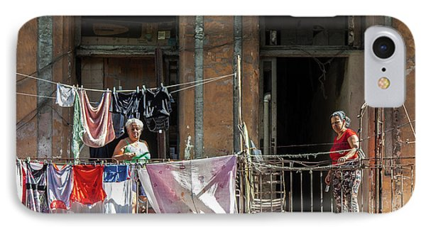 IPhone Case featuring the photograph Cuban Women Hanging Laundry In Havana Cuba by Charles Harden